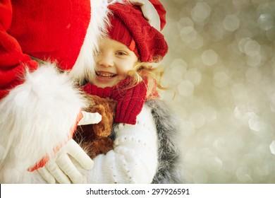 Happy little girl with Santa