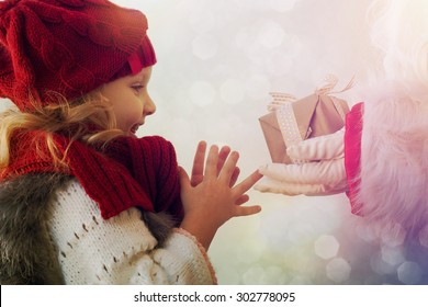 Happy little girl with Santa
