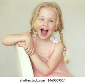 happy little girl screaming with open mouth