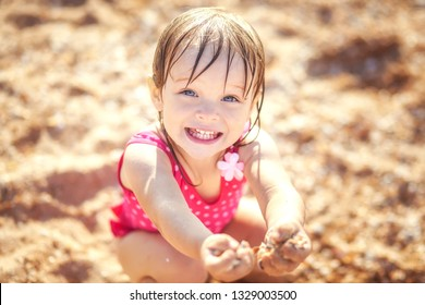 Happy little girl at sea