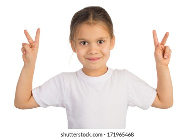 Happy little girl shows Victory sign with both hands. Isolated on white.
