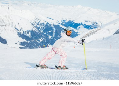 Happy little girl skiing downhill, Zellertal, Austria