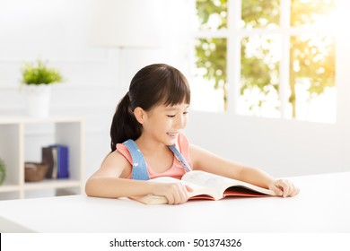 happy little girl study in the living room