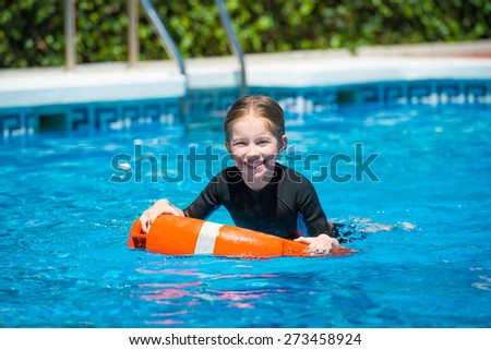 Happy Little Girl Swims Wetsuit Pool Stock Photo (Edit Now ... 4150efd29