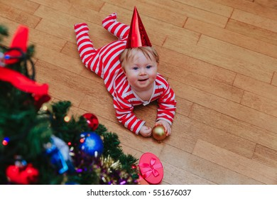 Happy little girl taking presents at Christmas