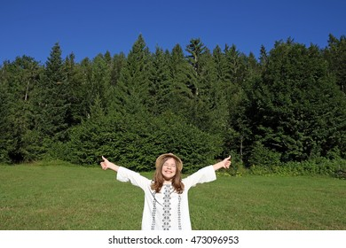 happy little girl with thumbs up enjoy in nature