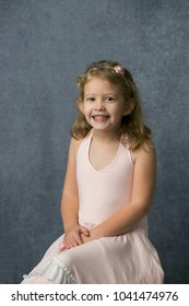 Happy Little Girl Twirling and Dancing in Pink Dress
