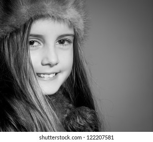Happy little girl in warm hat - black and white