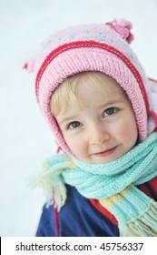 Happy little girl in winter portrait