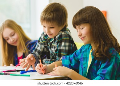happy Little girls and boy drawing pictures. Indoor at room