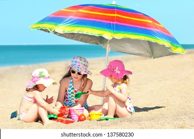 Happy little girls playing on beach