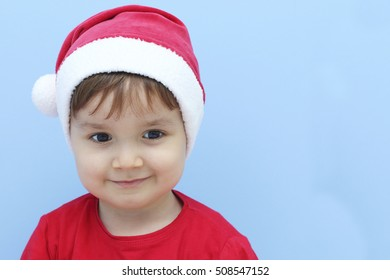happy little kid dressed as Santa Claus smiling