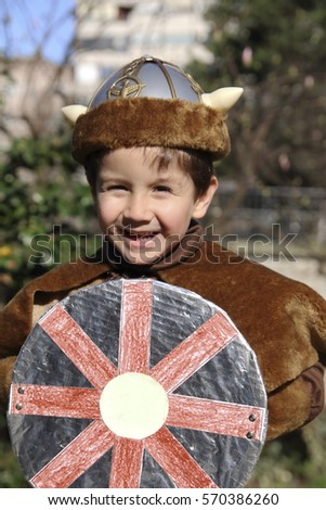 Happy Little Kid With A Viking Costume
