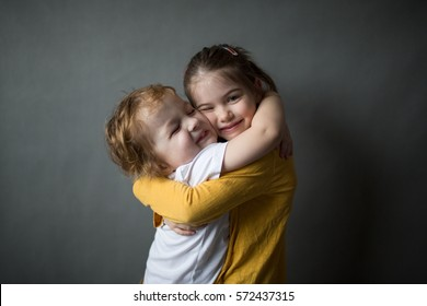 happy little kids hugging each other
