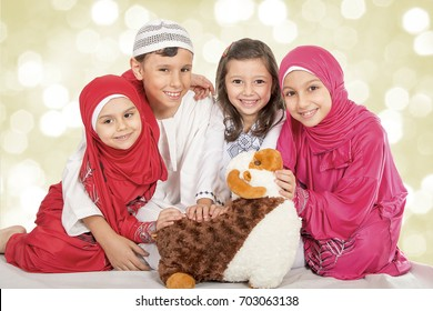 muslim kids images stock photos vectors shutterstock https www shutterstock com image photo happy little muslim kids playing sheep 703063138