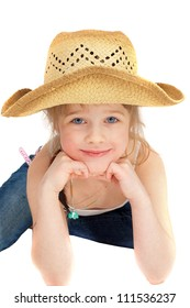Happy little pretty cowgirl portrait studio shoot isolated on the white background.