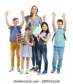 Happy little pupils with math teacher on white background