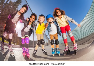 Happy little roller-skaters having fun outdoors