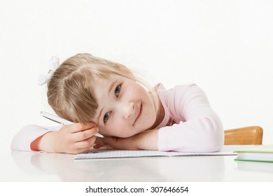Happy little school girl learning to write, white background