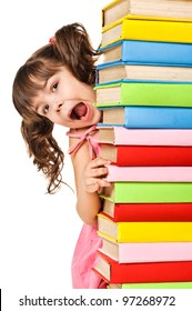 Happy little schoolgirl with a stack of books. Isolated over white