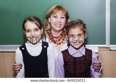 Happy Little Schoolgirl And Teacher At The Blackboard
