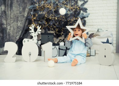 Happy little star. New Year 2018, Christmas. Smiling funny two year old baby girl.