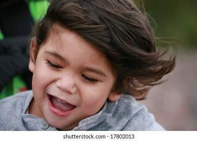 Happy little toddler boy smiling at the beach. Part Scandinavian, Thai background
