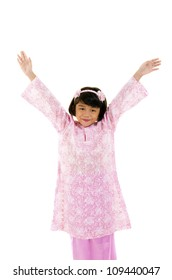 happy little young malay asian girl with baju kurung