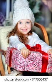 Happy Llittle pretty girl with Christmas and New Year gifts