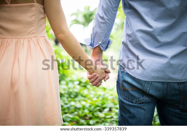 Happy love  couple holding hands in the morning at outdoor