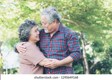 Happy love Elderly couple , Senior couple old man and senior woman relaxing hug in a forest
