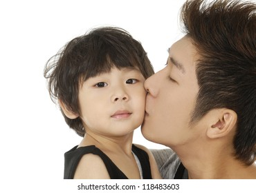 Happy love family with child - father kissing his son- closeup