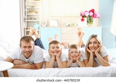 Happy lovely family on bed