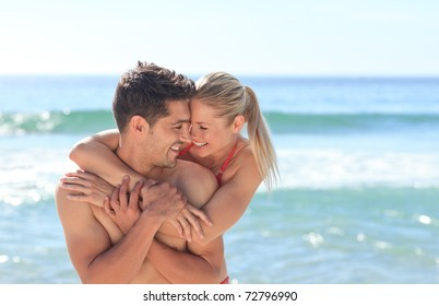 Happy lovers at the beach