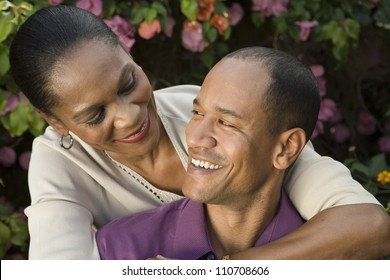 Happy loving couple embracing while looking at each other