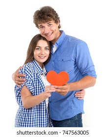 Happy loving couple. Enamored couple of young people. Portraits man and woman holding in their hands red hearts. Symbol of love. Valentine's Day.