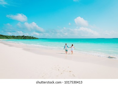 happy loving couple enjoy tropical beach