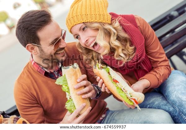 Happy loving couple enjoying breakfast in the city,having fun.