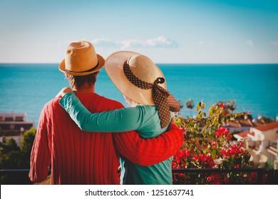 happy loving couple hug on balcony terrace with sea view
