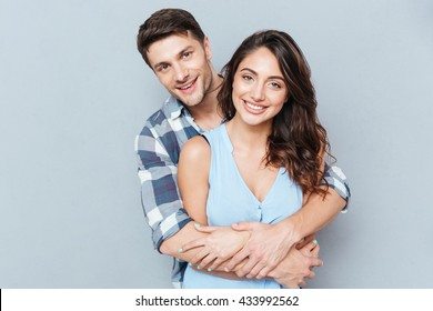 Happy loving couple isolated isolated on gray background