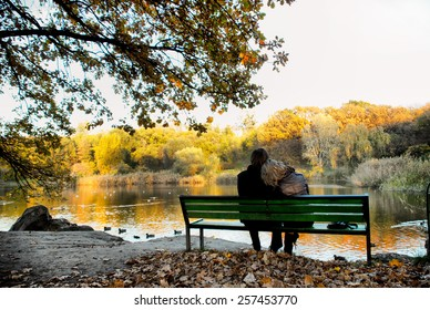 Happy loving couple next to a lake
