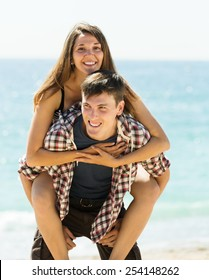 Happy loving couple  at seaside in summer day