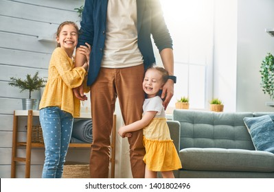 Happy loving family. Daddy and his daughters children girls playing together. Father's day concept.