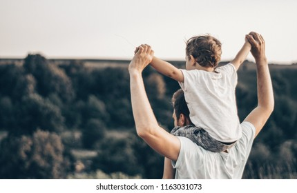 Happy loving family. Father and his son baby boy playing and hugging outdoors. Concept of Father's day.