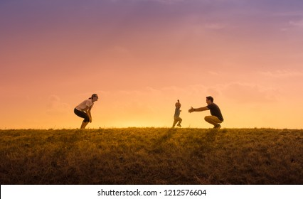 Happy loving family. Father, mother and son playing in the park. Parenting lifestyle concept.