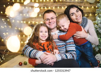happy loving family hugging in christmas house