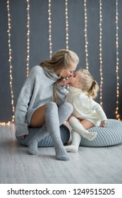 Happy loving family. mother and child girl playing, kissing and hugging. new year and christmas holidays