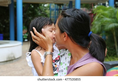 Happy loving family. mother and child girl playing, kissing and hugging
