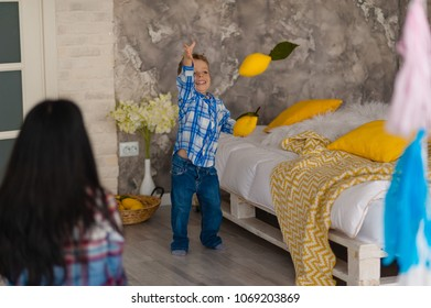 Happy loving family. Mother and her son play in children room. Funny mom and lovely child having fun indoors. By Nataliia Sdobnikova