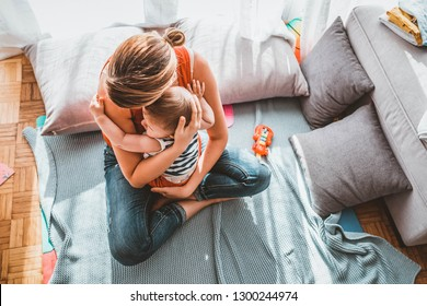 Happy loving family. Mother and her child baby boy playing in the summer day. Mother and child boy play together indoors at home. Happy young mom holds little child and gently hugging his little body